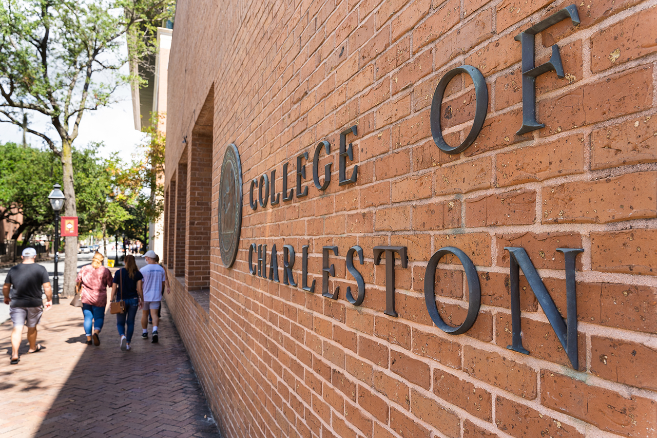 the words college of charleston on a brick wall on the campus