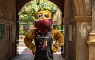 Clyde the Cougar wears a mask for the Cougar Pledge at the College of Charleston.