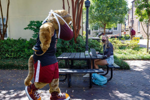 clyde the cougar greets freshman Chandler Bryant