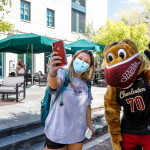 President Hsu & Clyde Hand Out Masks and hand sanitizer to students on campus.
