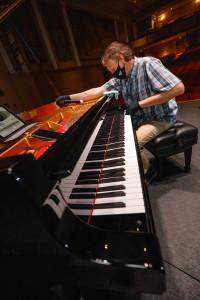 a piano tuner tunes the piano