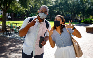 Students, faculty and staff all wearing masks on campus.