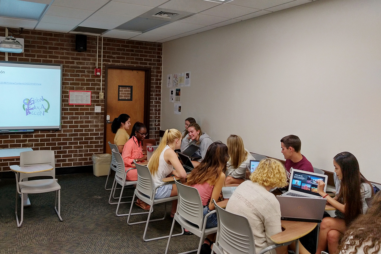 students interact with native spanish speakers online in a globally connected course