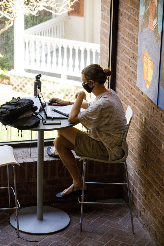 A student takes an online class during the COVID-19 pandemic in the Stern Student Center at the College of Charleston.