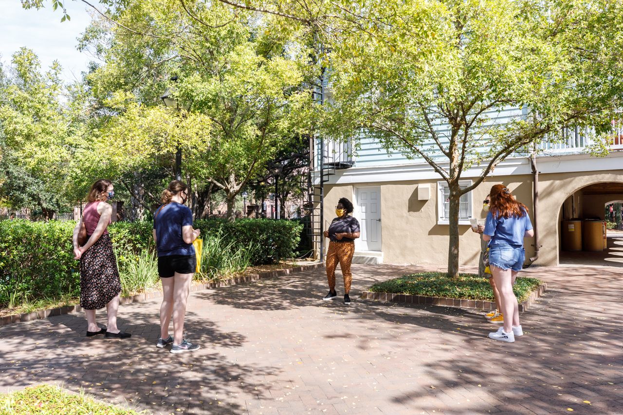 Prospective students and their families take a socially distanced tour of the College of Charleston during the COVID-19 pandemic.