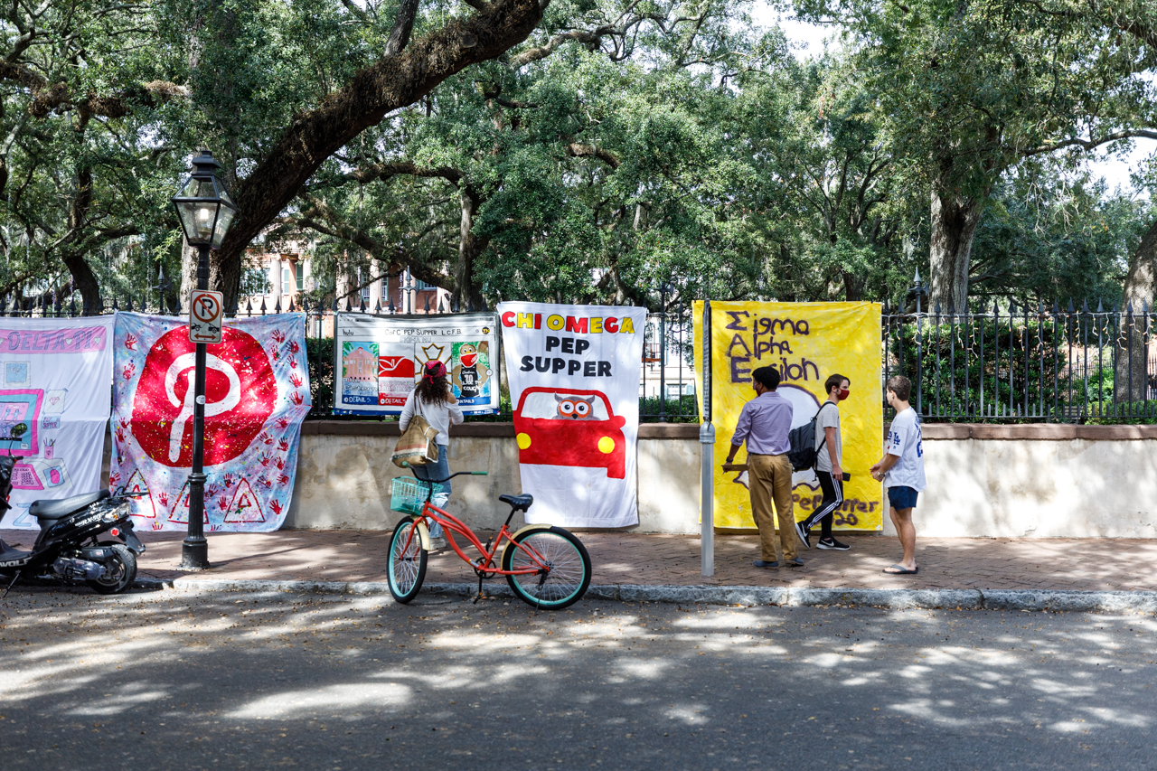 Greek life Pep Supper signs hang on the fence around Cistern Yard at the College of Charleston.