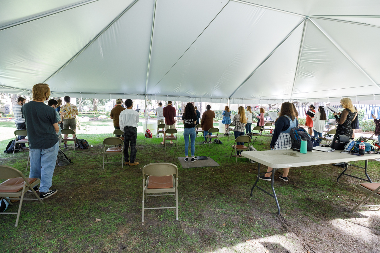 Professor Rob Taylor's Concert Choir class is held under a tent in Cistern Yard during the COVID-19 Pandemic.