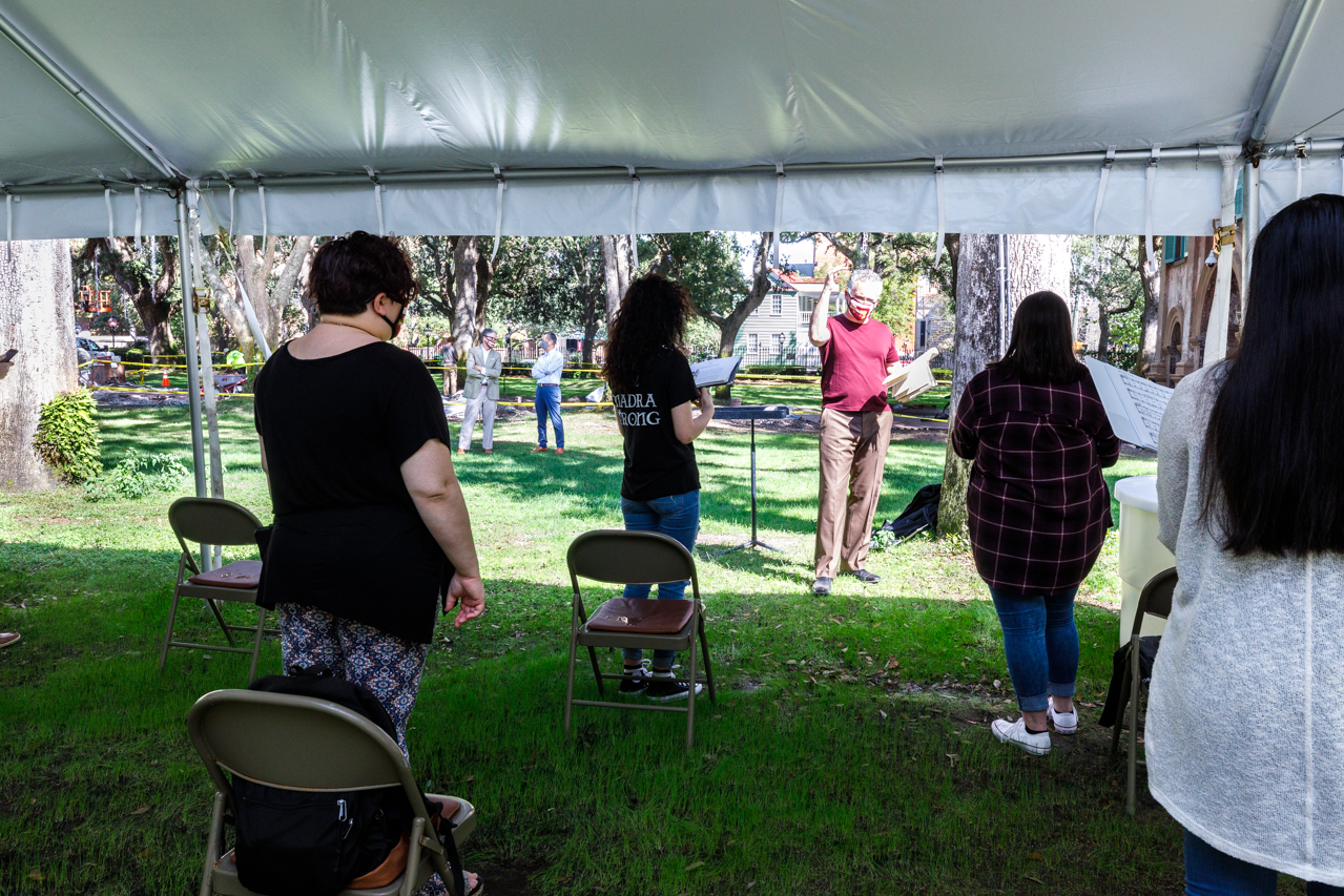 Professor Rob Taylor's the Madrigal singers class held under a tent in Cistern Yard during the COVID-19 Pandemic.