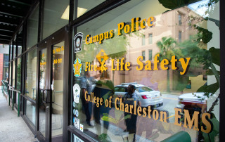 the glass window of the department of public safety at the college of charleston