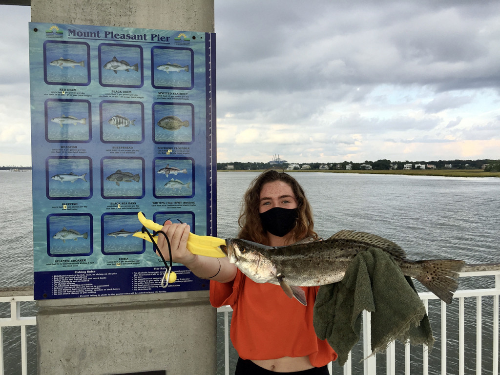 a student caught a fish during fishing on fridays