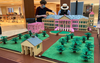 CofC students build a model of Cistern Yard with Legos at the Addlestone Library.