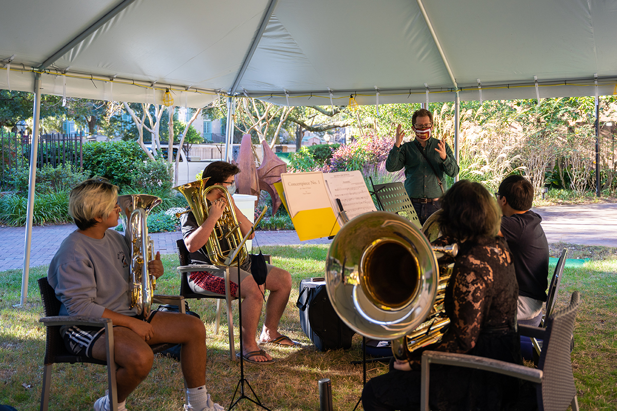 Brass musicians rehearse during a practice session in Barnet Courtyard.