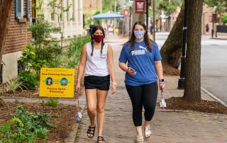 students walk on george street