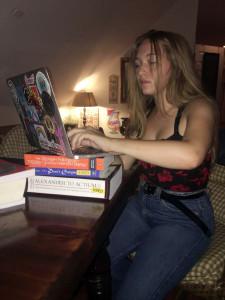 Reese Walker writes on a laptop