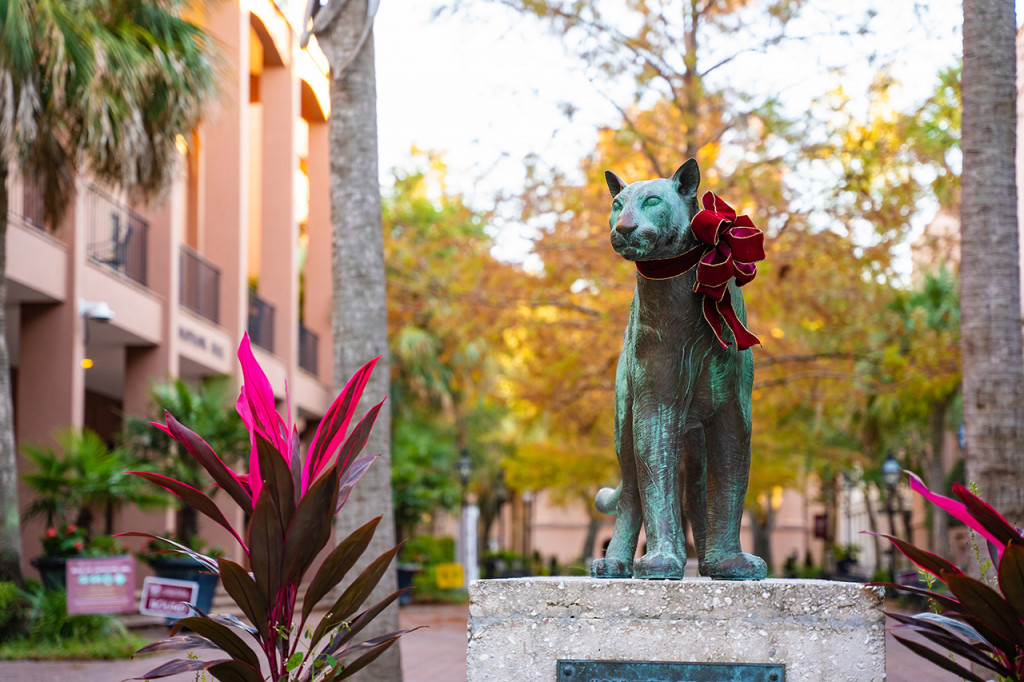 clyde the cougar statue wearing a red bow