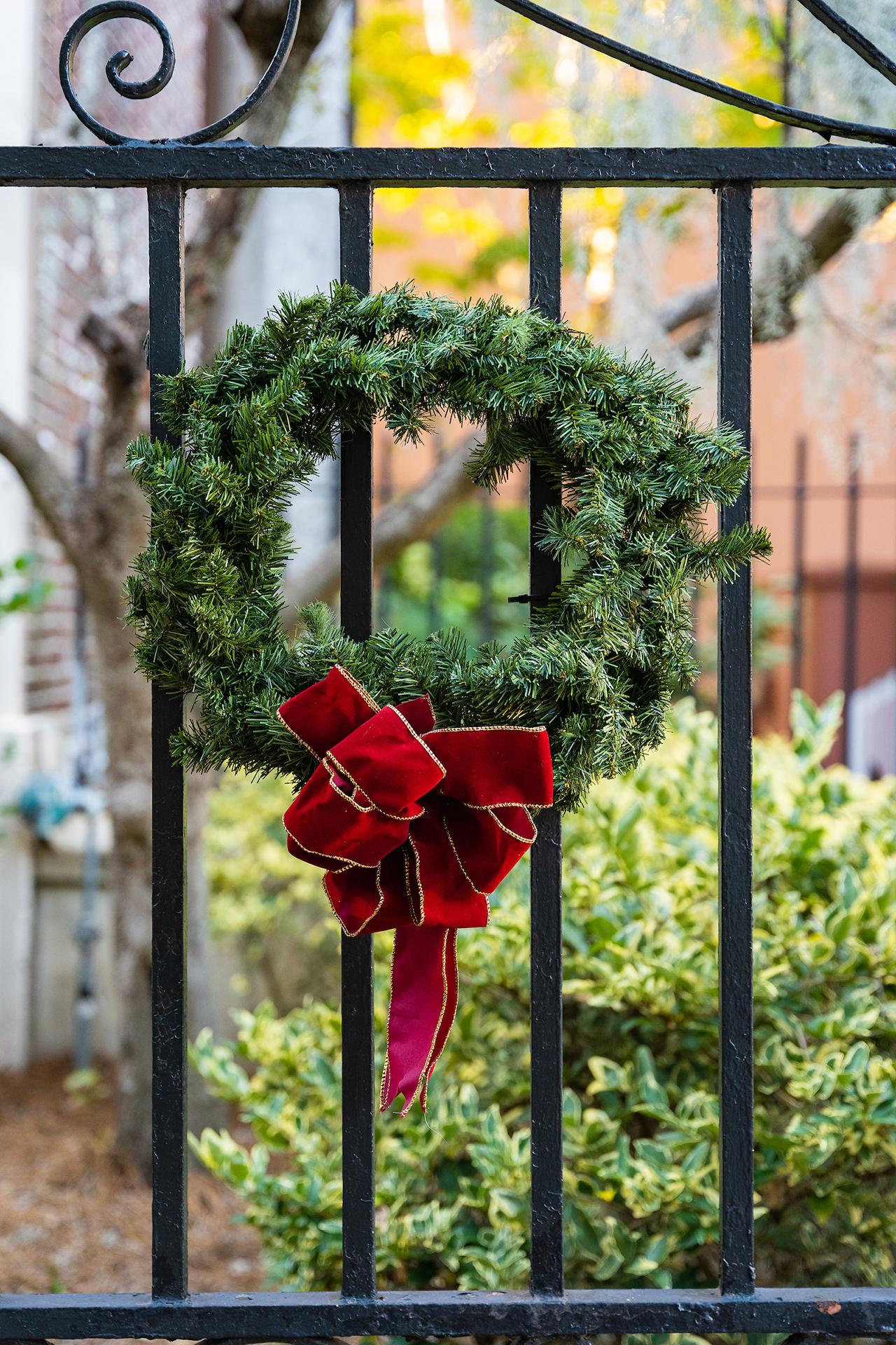 a wreath on a gate