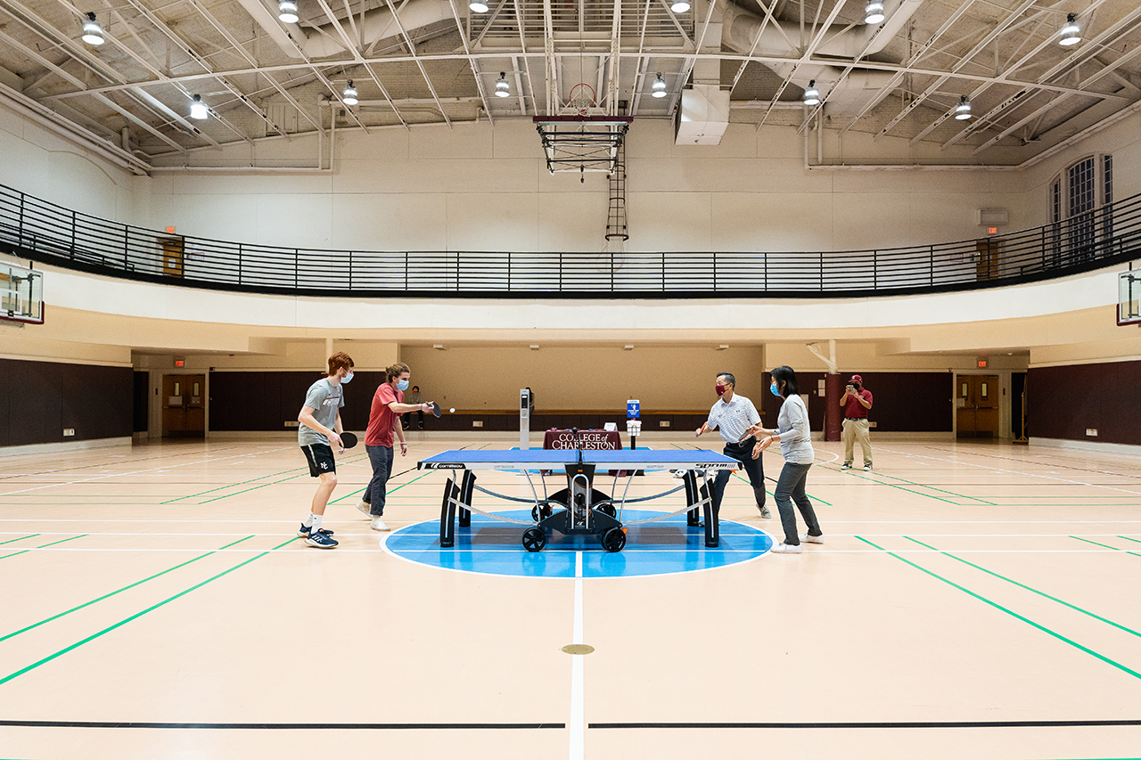 President Andrew Hsu and Dr. Rongrong Chen play ping pong with College of Charleston students at the Willard A. Silcox Physical Education and Health Center.
