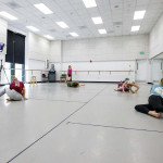students dance in a hybrid choreography class