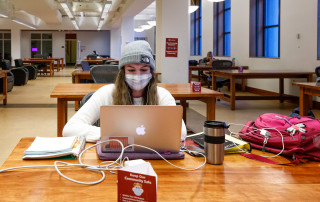 Students study and take their finals in the Addlestone Library while socially distanced during the COVID-19 Paandemic.