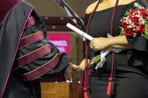 a graduate holds a diploma