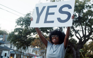 woman holding a yes sign