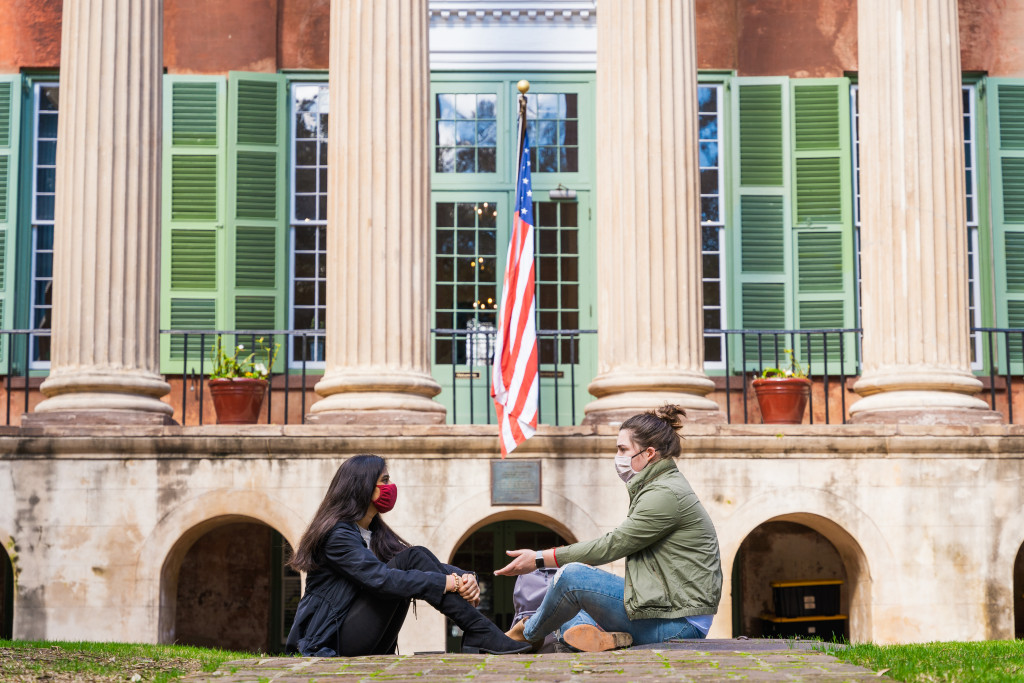 Two students convene on the Cistern in front of Randolph Hall, College of Charleston.