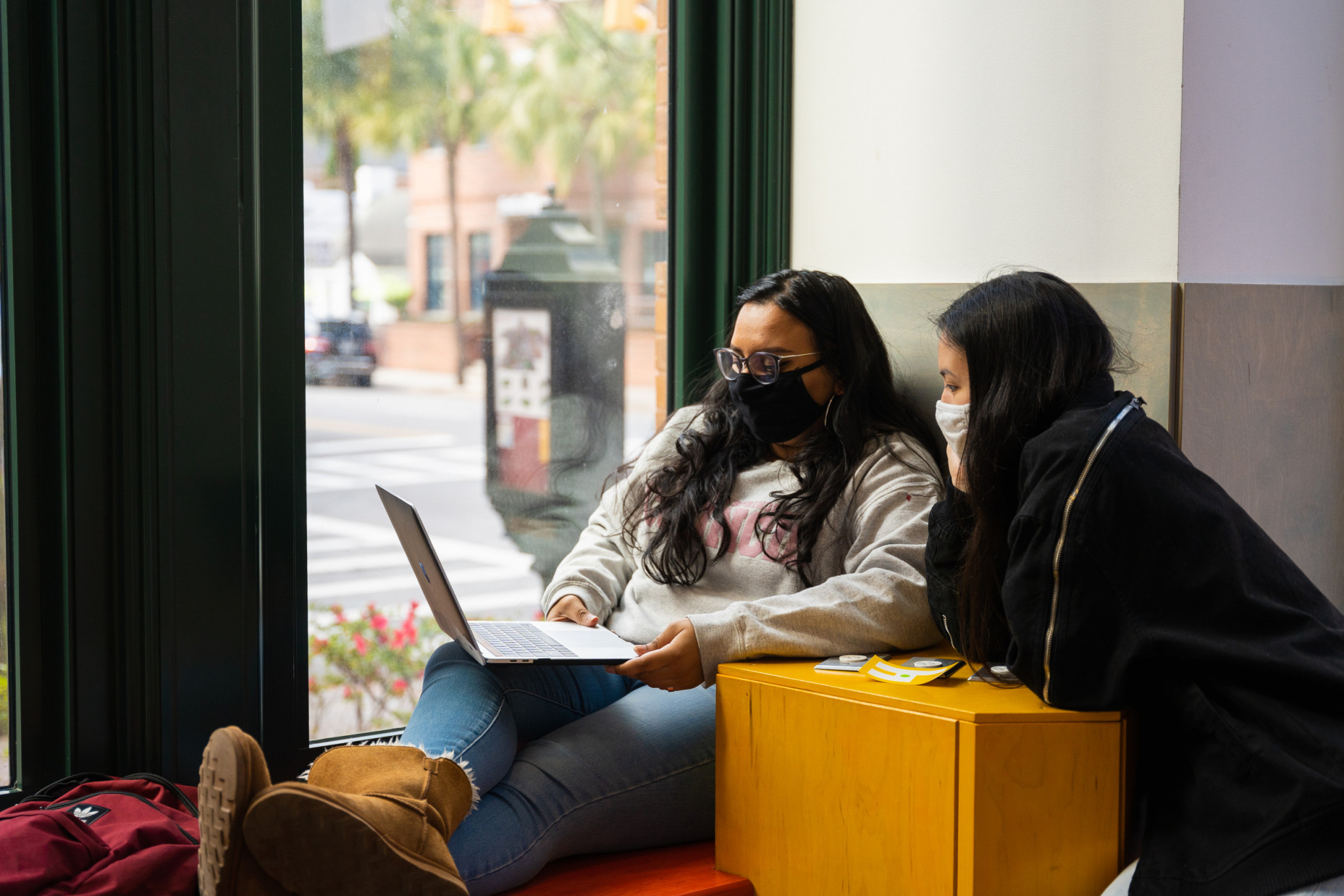 Students attend an online meeting in a small study space, The Halsey Gallery, College of Charleston.