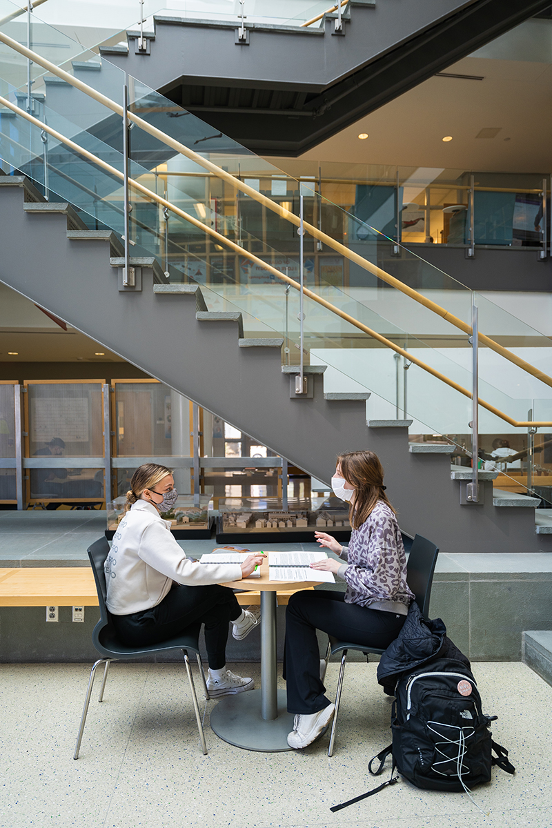 Students study together in the lobby of SSMB.