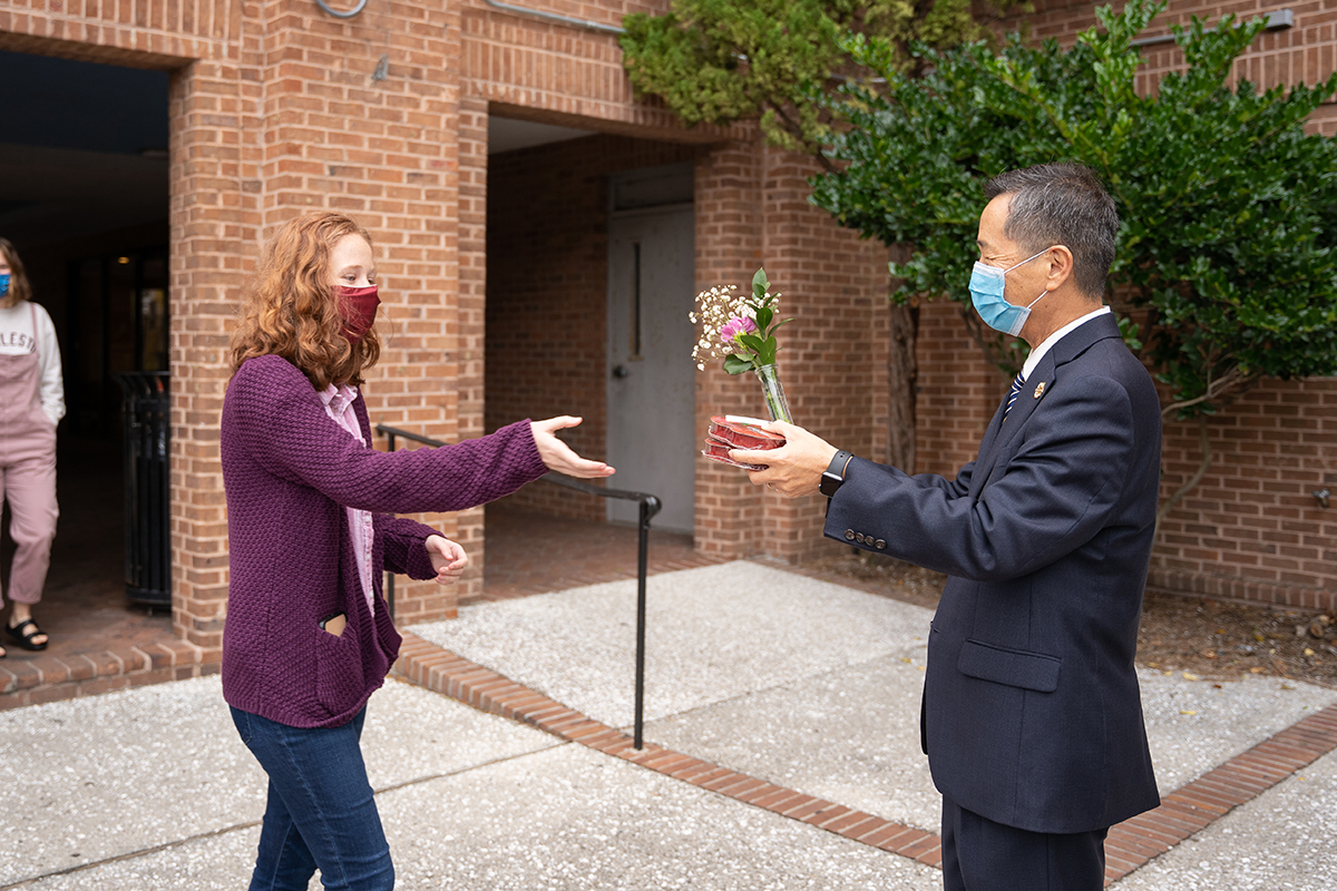 CofC President Andrew Hsu delivers candygrams to students for Valentines Day.