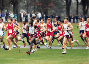 Derrick Williams running with a group of runners during a meet in the 1990s