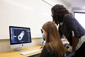 a student works with a professor to learn cad stoftware