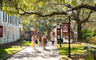 students walking on the college of charleston campus