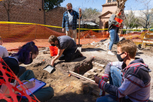 Student volunteers work at a dig site on the College of Charleston campus.