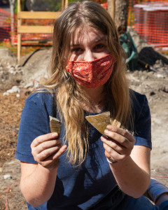 History and archaeology major Audrey Grau displays artifacts collected at a dig site on the College of Charleston campus.