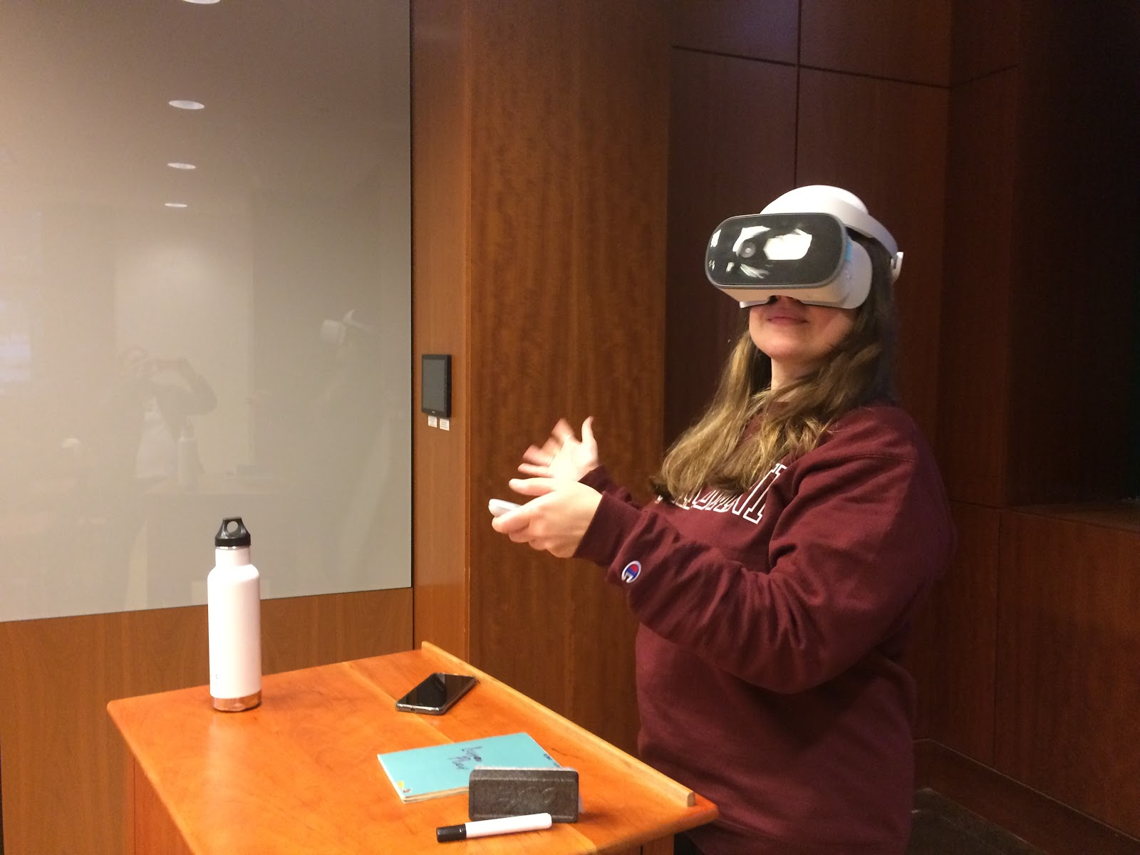 a student uses VR goggles