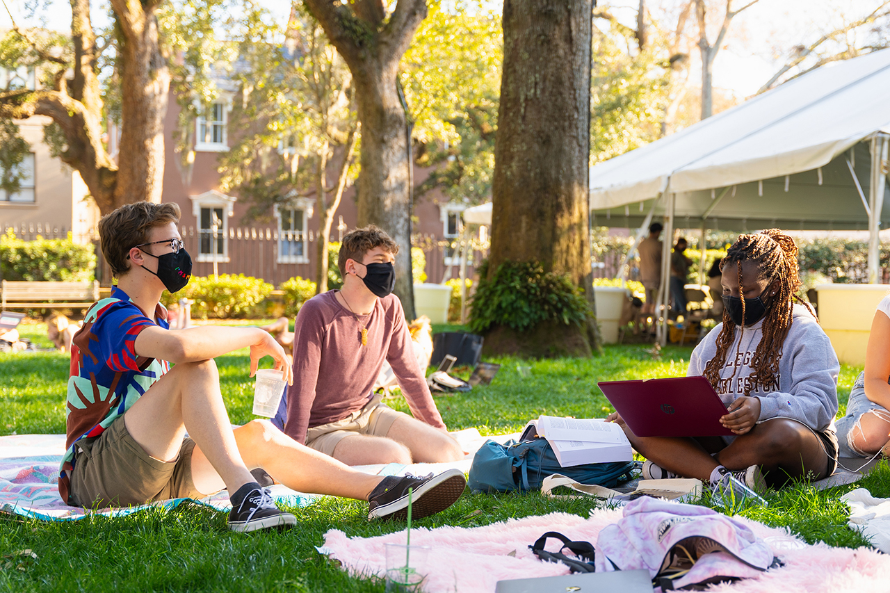 students studying outside with face masks on
