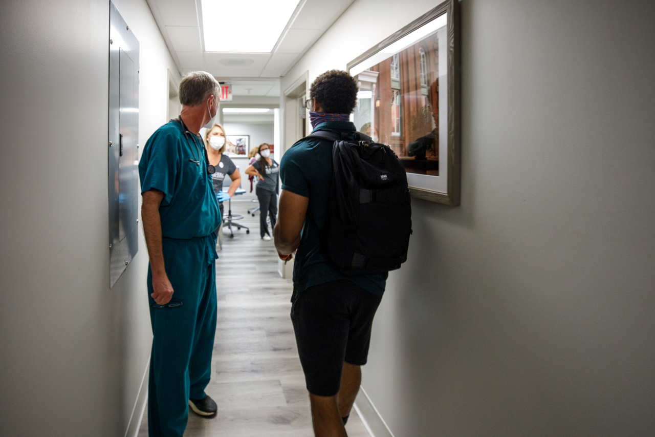A student walks into student health services to get his COVID Vaccine.