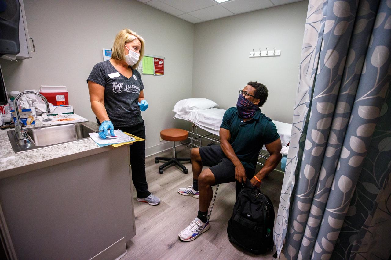 A nurse preps a CofC student to get the Moderna COVID Vaccine.