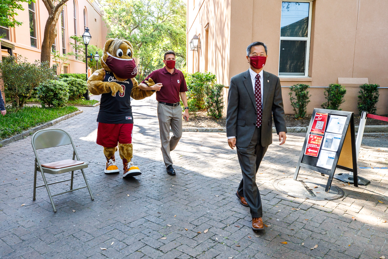 President Andrew Hsu, Clyde and Vice President of Communications Ron Manchaca walk over to Student Health Services to talk with students getting their COVID-19 vaccines.