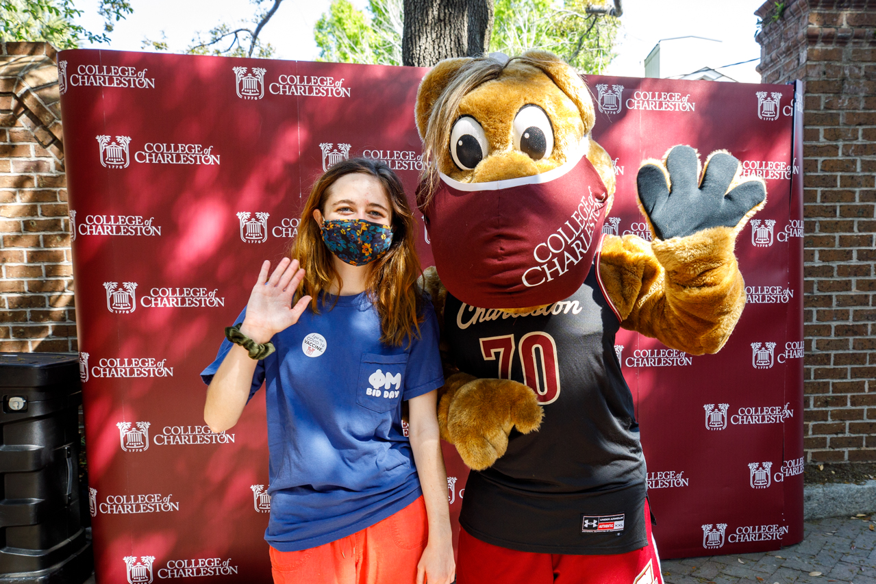 CofC students pose with Clyde after getting their first Moderna COVID-19 vaccine.