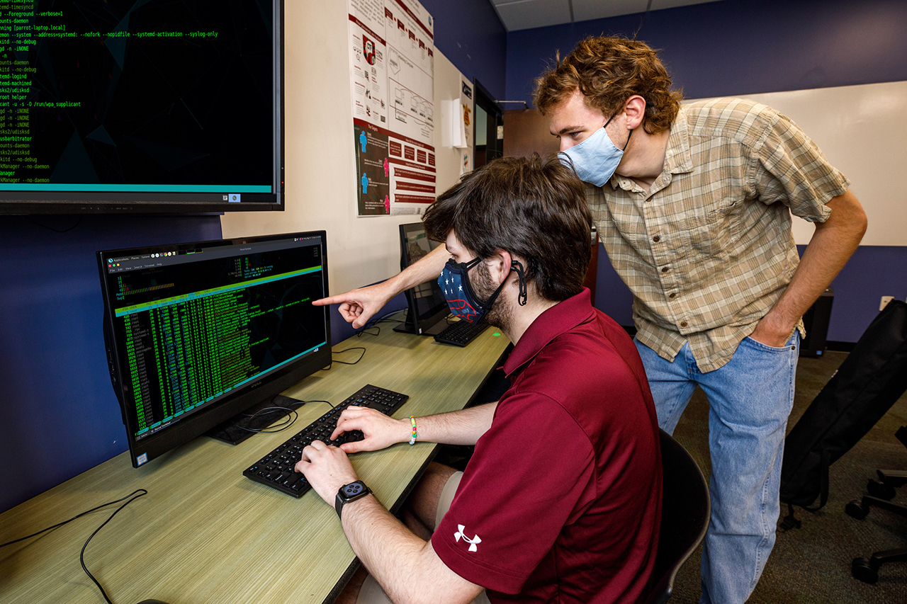 Ross Clarke and Patrick McCabe, members of the cyber security team at CofC.