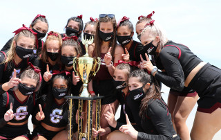 CofC Cheerleading team holding trophy