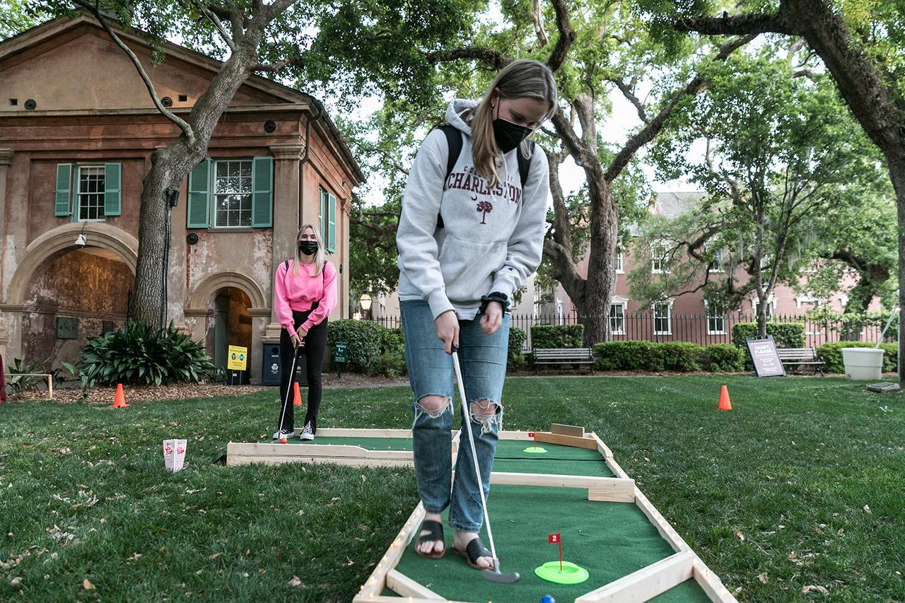 students play putt putt