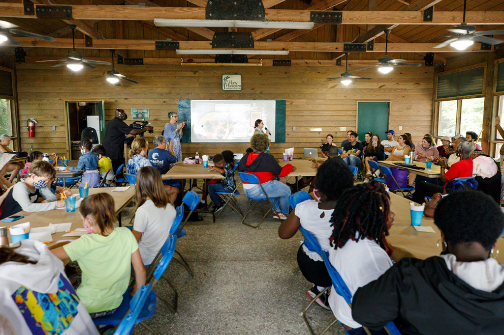 children listen to science presentations