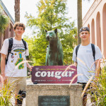 Students pose with the Clyde the Cougar statue at Cougar Mall for First Day of Class photos.