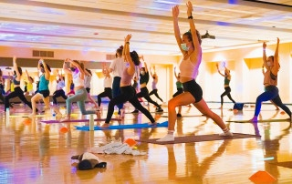 Students stretch and breathe at Glowga, part of College of Charleston's Weeks of Welcome.