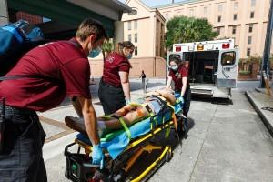 cofc student emt volunteers practice an emergency scenario