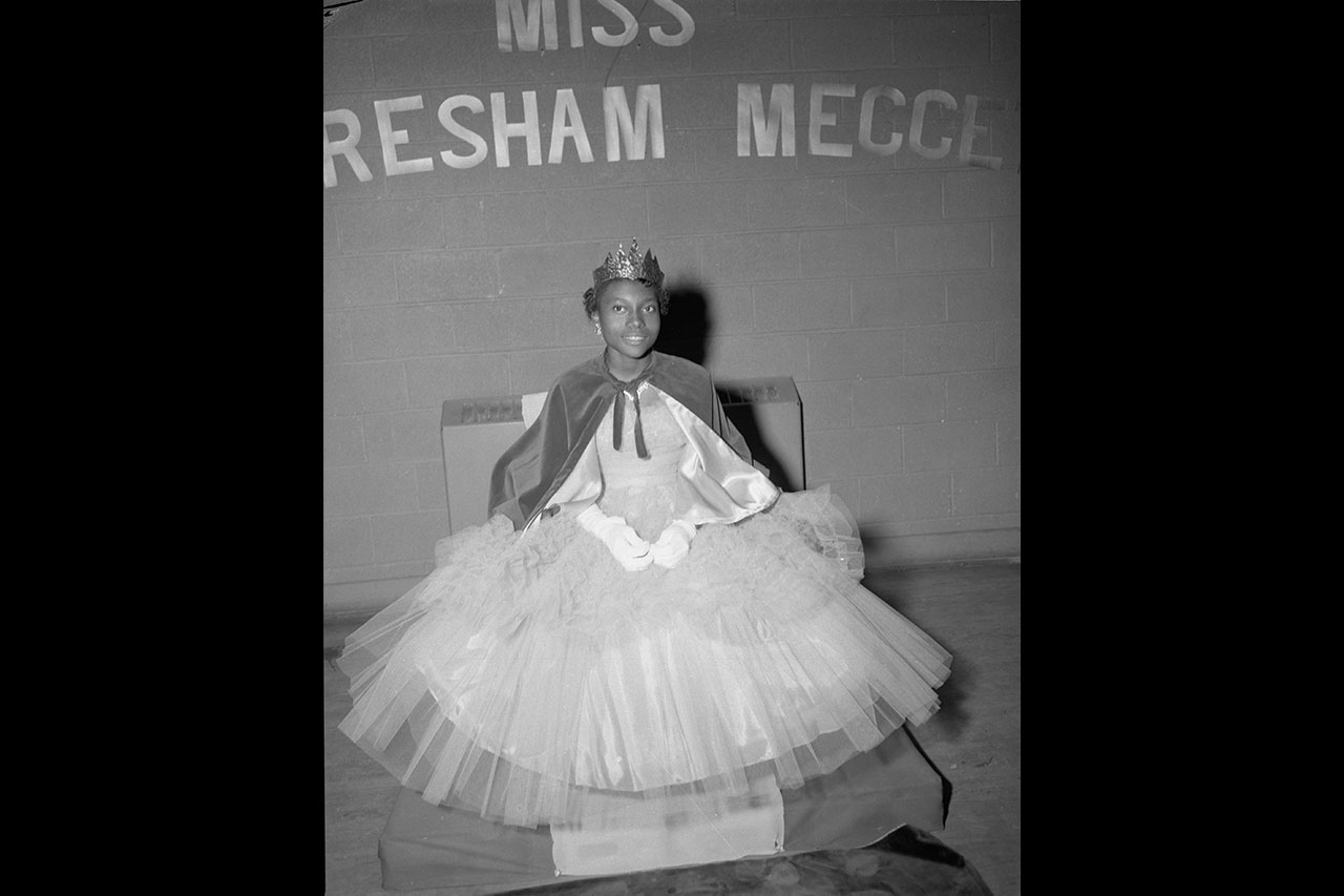 A black and white photo of the Gresham-Meggett School Homecoming Queen