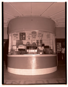 a black and white photo of a snack bar in the mid-1900s