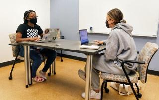 peer educator janae dorsey tutors a student